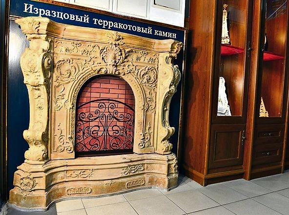 Камин из старого дома и печь с медалями